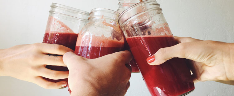 hands-mason-jars-beetroot-juice