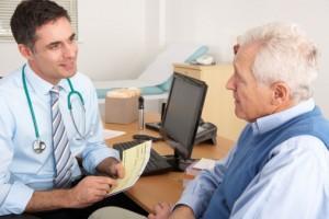 General Practitioner talking to senior man in surgery