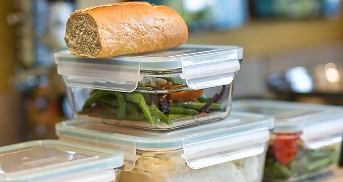 close-up-of-containers-of-leftovers-stacked-on-kitchen-counter-meal-food-indoors-bread-lunch_t20_7mXJg7 (1)