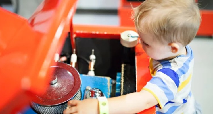 toddler-boy-pretending-to-fix-the-engine-on-a-car_t20_Ko4KG0 (1)-1