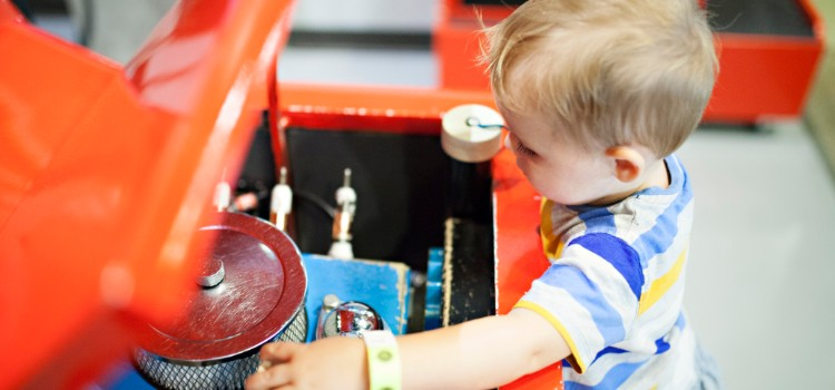 toddler-boy-pretending-to-fix-the-engine-on-a-car_t20_Ko4KG0 (1)